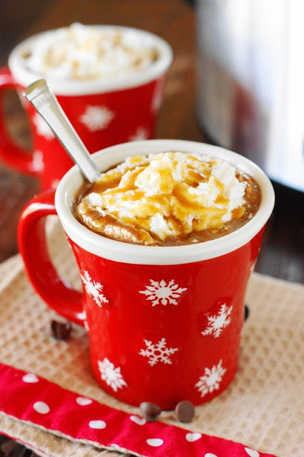 Slow Cooker Caramel Hot Chocolate - Put the ingredients for this holiday drink in your crockpot and in a few hours, you will have the happiest of holidays. {via The Kitchen is My Playground}